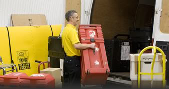 Ian Wilson Events technician loading conference items on to van
